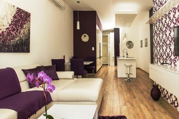 purple living rooms design basilica apartments accommodation